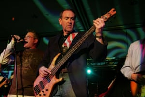 Mike Huckabee plays bass with his band Capitol Offense.