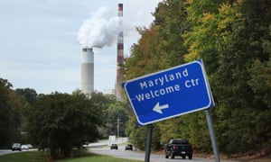 Emissions spew from a large stack at the coal-fired Morgantown generating station in Newburg, Maryland.