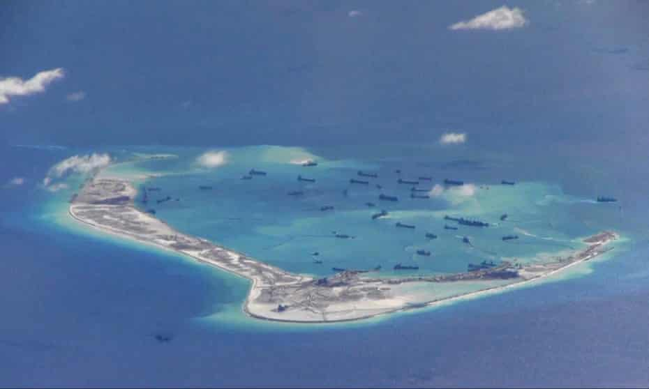 A US navy image purportedly shows Chinese dredging vessels in the waters around Mischief Reef where USS Dewey carried out a 'freedom of navigation operation'.