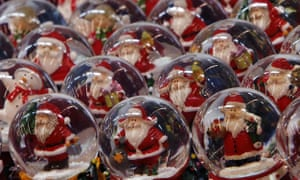 Santa Claus snow globes on display at a German Christmas market