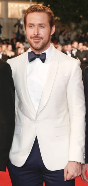 Ryan Gosling tops off with a white suit jacket at Cannes.