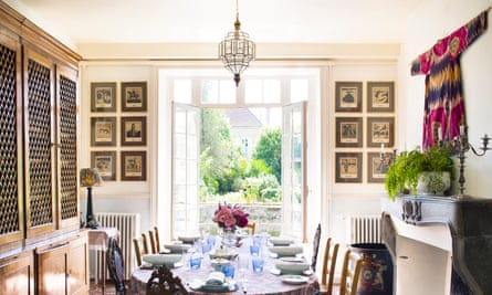 'Benign beauty': the dining room with tomette tiles and Uzbek coat hanging.