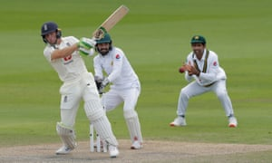 Jos Buttler smashes a four off Shadab Khan during his match-winning partnership with Chris Woakes at Old Trafford on Saturday.