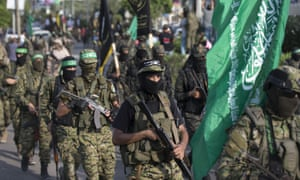 Militants from the Izz ad-Din al-Qassam Brigades, the armed wing of the Palestinian Hamas movement, parade in Gaza City on Tuesday.