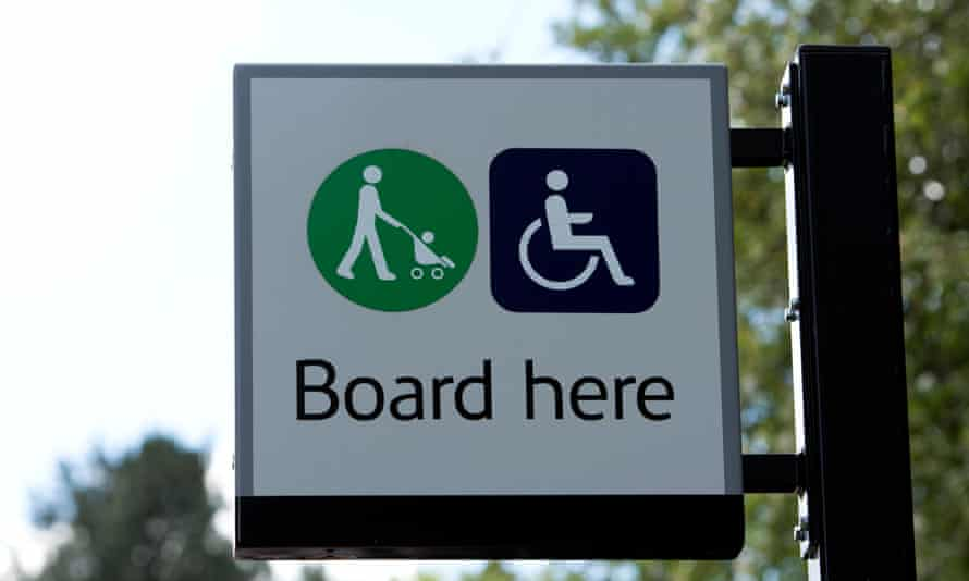 Pushchair and wheelchair boarding sign at UK railway station.