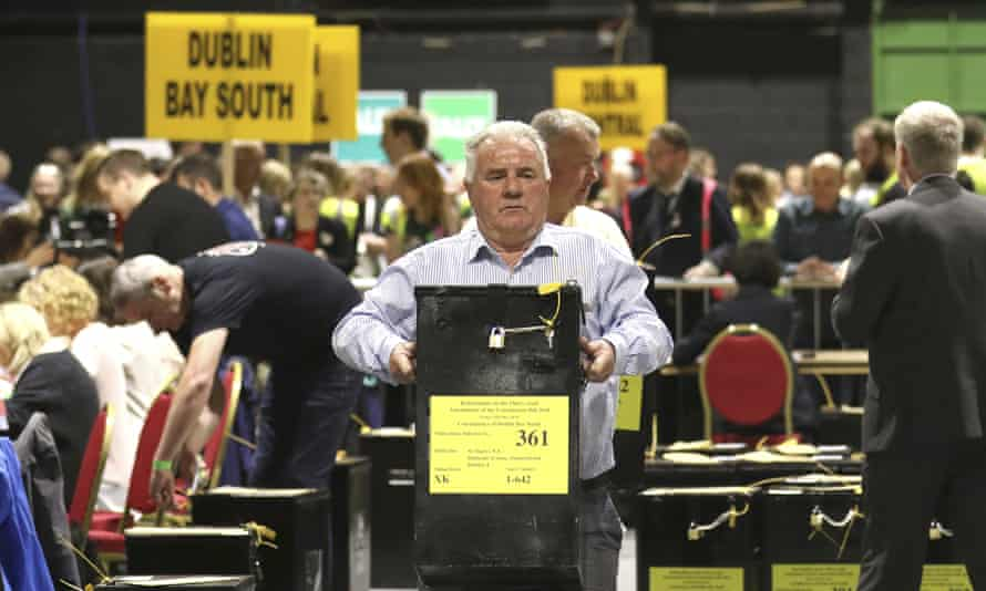 A man carries a ballot box during the Irish referendum on repealing the eighth amendment