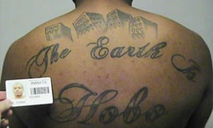 Defendant Paris Poe's back tattoo reads: 'The Earth Is Our Turf' and Hobo.