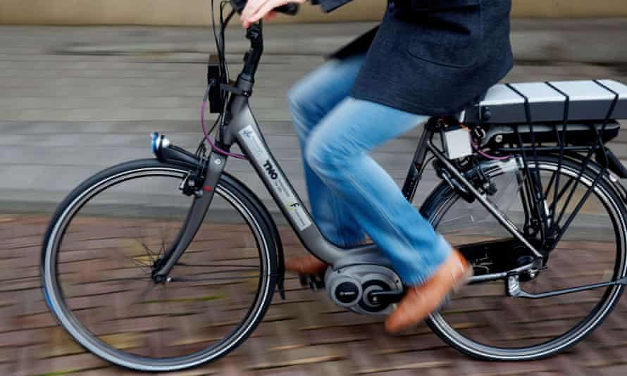 A man tests a bike with special safety technology in The Hague. The electrical bike has radar on the front and a camera at the back.