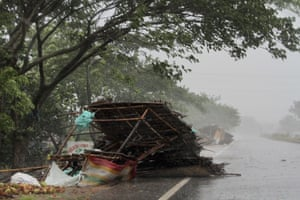 A roadside stall collapses in the winds