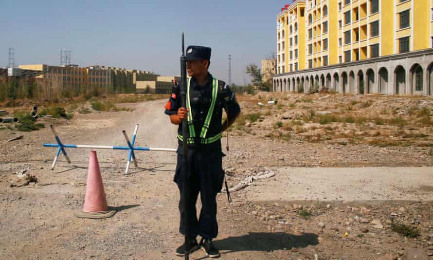 A policeman guards a 'vocational education centre' in Xinjian.