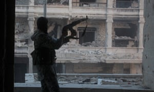 A Syrian rebel fighter fires his rifle during an attempt to break the siege of Aleppo.
