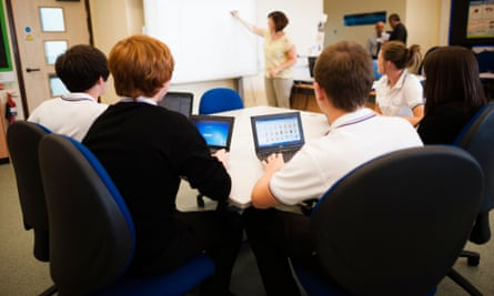 A level pupils using computers in class at a secondary school