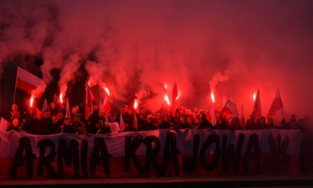 Polish nationalists at a 2017 march in Warsaw, which was attended by far-right figures including Tommy Robinson and Roberto Fiore.