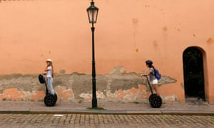 Tourists ride on Segways through a street in central Prague, Czech Republic. The vehicles are to be banned due to 'safety' concerns.