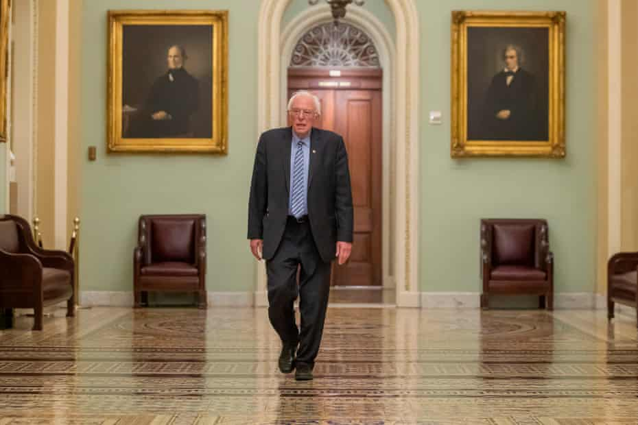Bernie Sanders walks near the Senate chamber during the coronavirus relief bill at Capitol Hill in Washington DC, on 25 March.