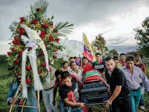 Friends, relatives and members of the local community carry the coffin of Gerson Acosta up a hill to the graveyard. The murders of local civil society leaders pose a serious risk to the peace process