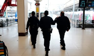 French police officers patrol inside the Gare du Nord train station in Paris.
