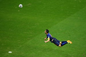 Robin van Persie scores the the Netherlands' first goal during their 2014 World Cup group game against Spain