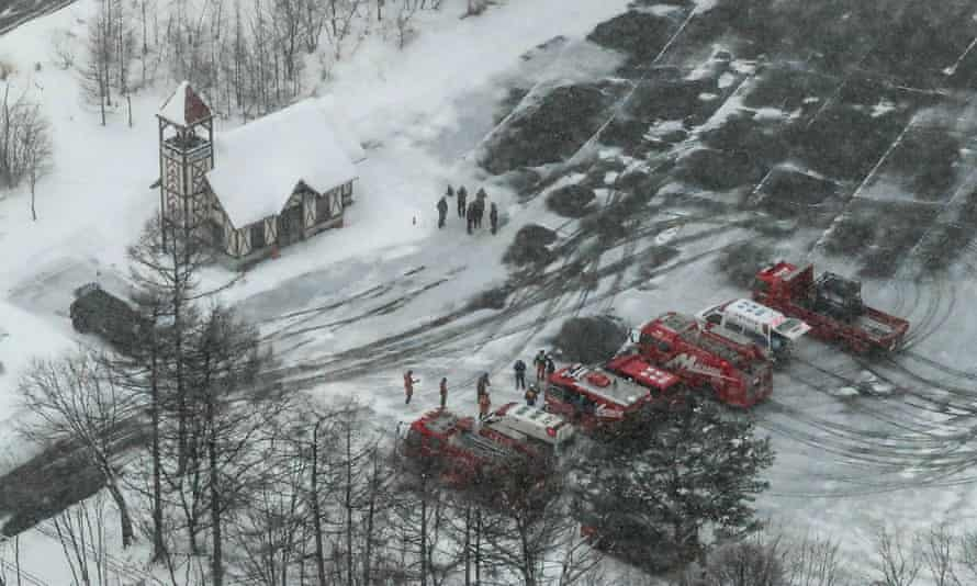 Ambulances and fire vehicles parked at a ski resort in the town of Kusatsu.