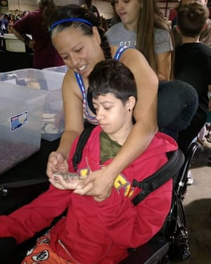 Karina Cesena attends to her daughter, Jazzmyne Morris, who is a resident at the Hacienda HealthCare home in Phoenix, Arizona.