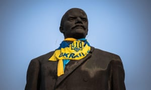A statue of Lenin dressed with a Ukrainian flag in the east of the country