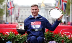 Great Britain's David Weir celebrates winning the men's wheelchair race.