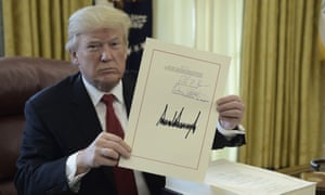 Donald Trump displays his signature after signing the tax cut bill on 22 December 2017.
