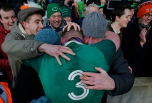 Tadhg Furlong is congratulated by friends and family after the Grand Slam victory for Ireland after the England v Ireland Six Nations match at Twickenham in March 2018.