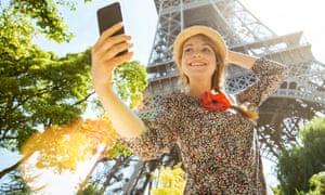 Woman taking selfie in Paris