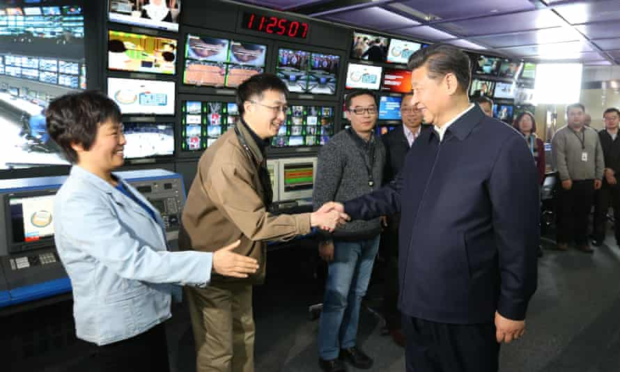 """President Xi Jinping shakes hands with staff members at the control room of China Central Television (CCTV) in Beijing during a tour in which he asked media to pledge absolute loyalty to the party and closely follow its leadership in """"thought, politics and action."""""""