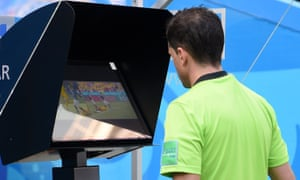 The referee Andrés Cunha makes World Cup history as he reviews VAR footage before awarding France a penalty during their Group C match against Australia.
