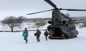 Royal Marines deliver aid to Nenthead, Cumbria, on Monday.