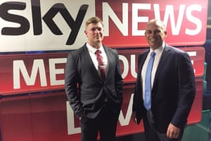 Far-right extremist Blair Cottrell with Adam Giles in front of the sky news sign.