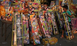 A boy shops for fireworks on the eve of Diwali in Amritsar, India