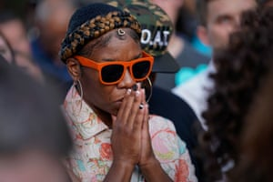 Dayton, Ohio: A woman prays at the scene of the shooting