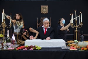 Tel Aviv, Israel Team members of the Israeli artist Itay Zalait work on an installation depicting the country's prime minister, Benjamin Netanyahu, at a mock Last Supper in one of many protests against his lengthy rule