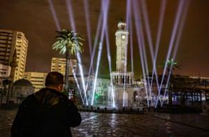 A light show illuminates Konak square in Izmir, Turkey, during a curfew