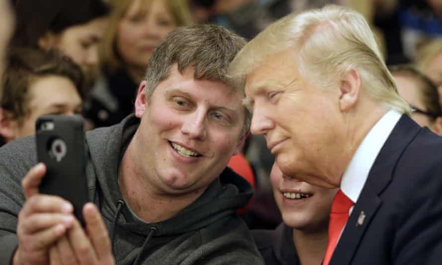 Donald Trump poses for a photo with a fan in Minnesota