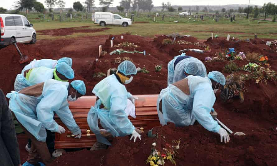 Funeral workers wearing PPE at the burial of a coronavirus victim