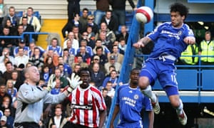 Chelsea midfielder Michael Ballack heads the ball past Sheffield United goalkeeper Paddy Kenny during a Premier League match at Stamford Bridge on 17 March 2007