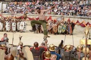 Fight club … gladiators tussle with a solo attacker during the Great Roman Games in Nimes, France.