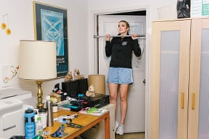 Elizabeth Swaney uses the pull-up bar in her room at her family's home in Oakland.