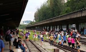Singaporeans make use of abandoned Tanjong Pagar railway station in an unusually informal way.