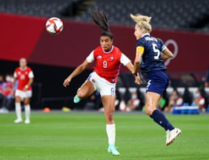 Maria Jose Urrutia in action with Steph Houghton.