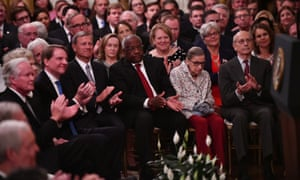 Most supreme court justices applaud during Brett Kavanaugh's swearing-in ceremony on Monday.