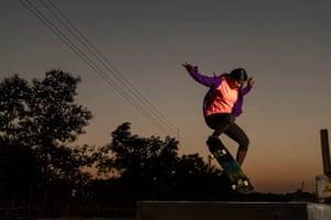 Asha Gond, director of Barefoot Skateboarders, demonstrates her skills