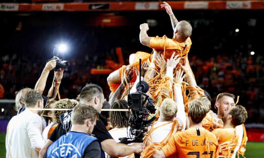 Wesley Sneijder is hoisted into the air by his team-mates after the final whistle.