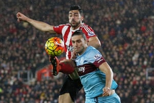 Graziano Pelle and Andy Carroll battle.