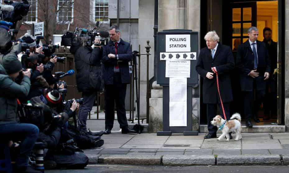Boris Johnson outside the polling station in London with his dog, Dilyn