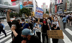 Protesters march over alleged police abuse of a Kurdish man in Tokyo and in solidarity with the Black Lives Matter movement.